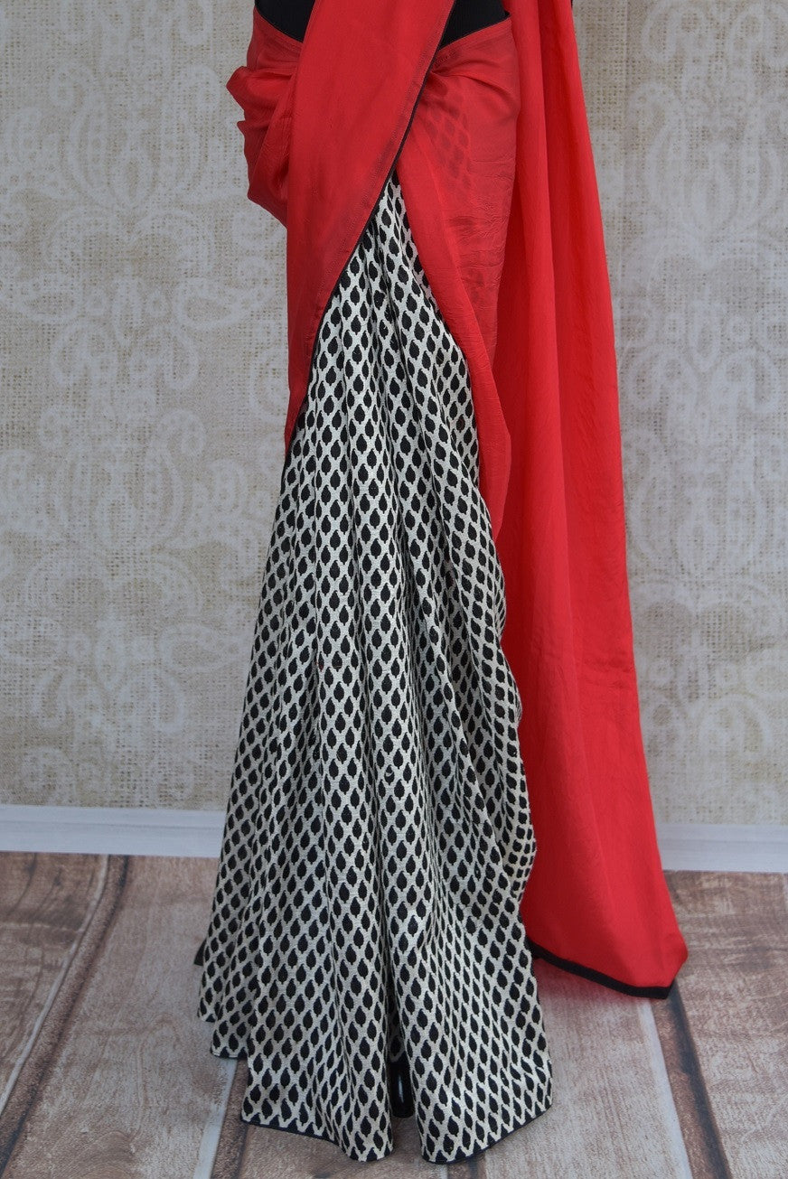 90A474 Give your ethnic clothing range a contemporary touch with this red, white & black, checked saree. This half crepe, half matka silk saree can be bought from Pure Elegance - our Indian wear store in USA.