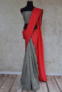 90A474 Give your ethnic wear collection a cool contemporary touch with this red, white & black, checked saree. This half crepe, half matka silk saree can be bought from our Indian fashion store in USA - Pure Elegance.