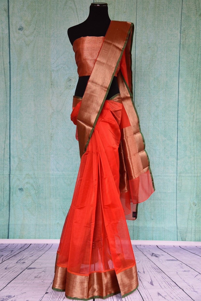 90C192 Classic red sari from India with a golden border and a thin green trim. This simple saree, ideal for festive wear, can be bought at our Indian wear store online in USA.