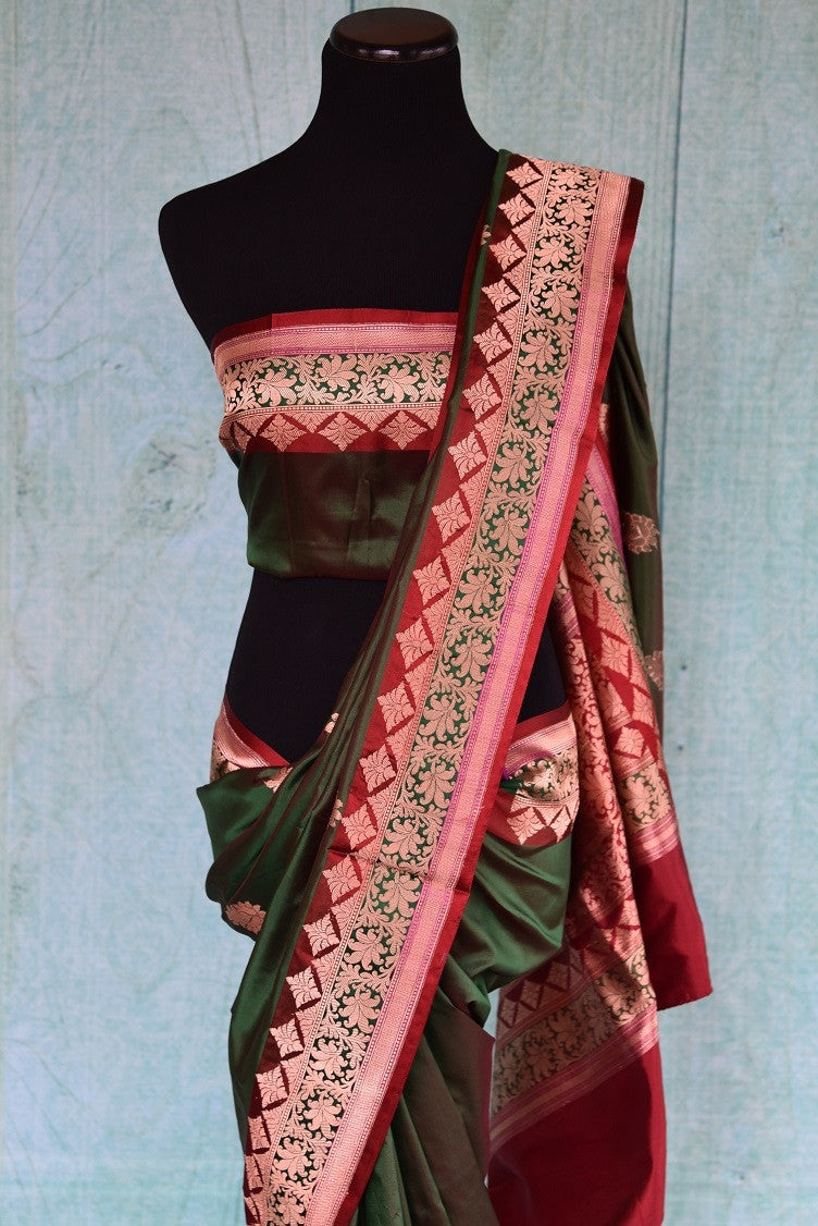 90A733 Traditional red & green saree from India is available at our online Indian clothing store in USA. The Indian Banarasi saree is the perfect Indian wedding outfit. Buy this timeless saree for your ethnic wardrobe today!