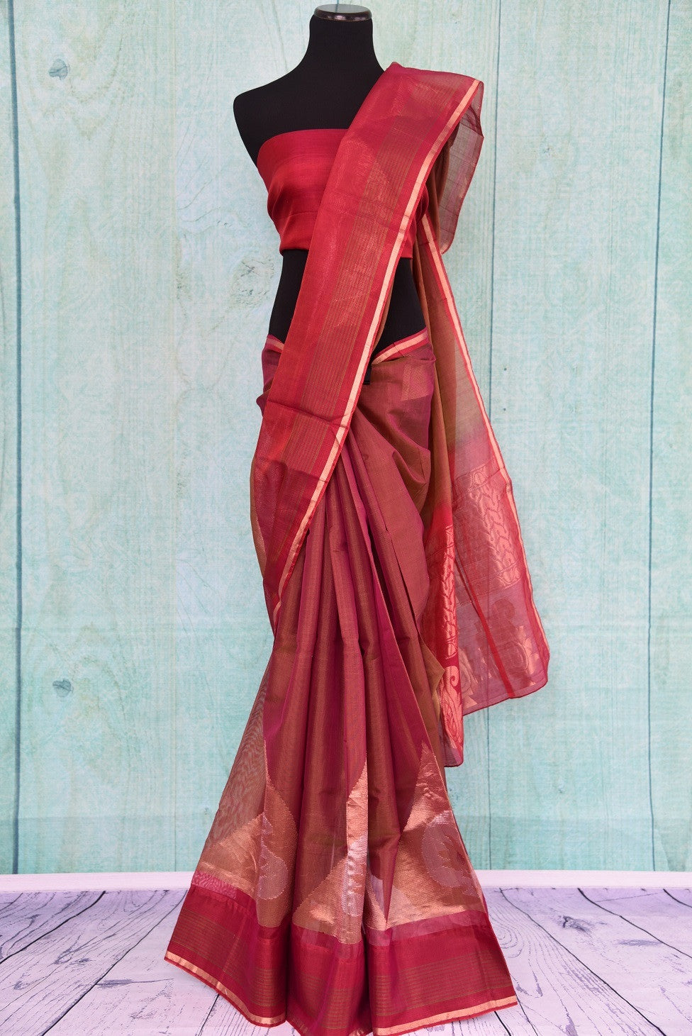 90C258 Traditional south silk saree available online in USA. The maroon and gold saree comes with paisley design and is great for festive occasions and pujas. This lovely saree is sure to be a versatile hit in your ethnic wear wardrobe.