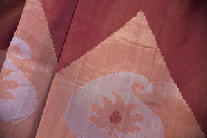 90C258 Simple, yet striking traditional south silk saree available online at Pure Elegance in USA. The maroon and gold saree comes with paisley design and is great for festive occasions and pujas. This ethnic saree is sure to be a hit no matter what the season!