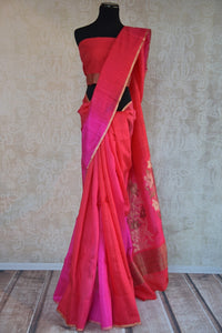 90C282 Traditional red and pink saree with an eye-catching floral zari pallu. The traditional Indian matka Banarasi saree is an evergreen pick for your ethnic wear wardrobe that you are sure to love no matter what the season!