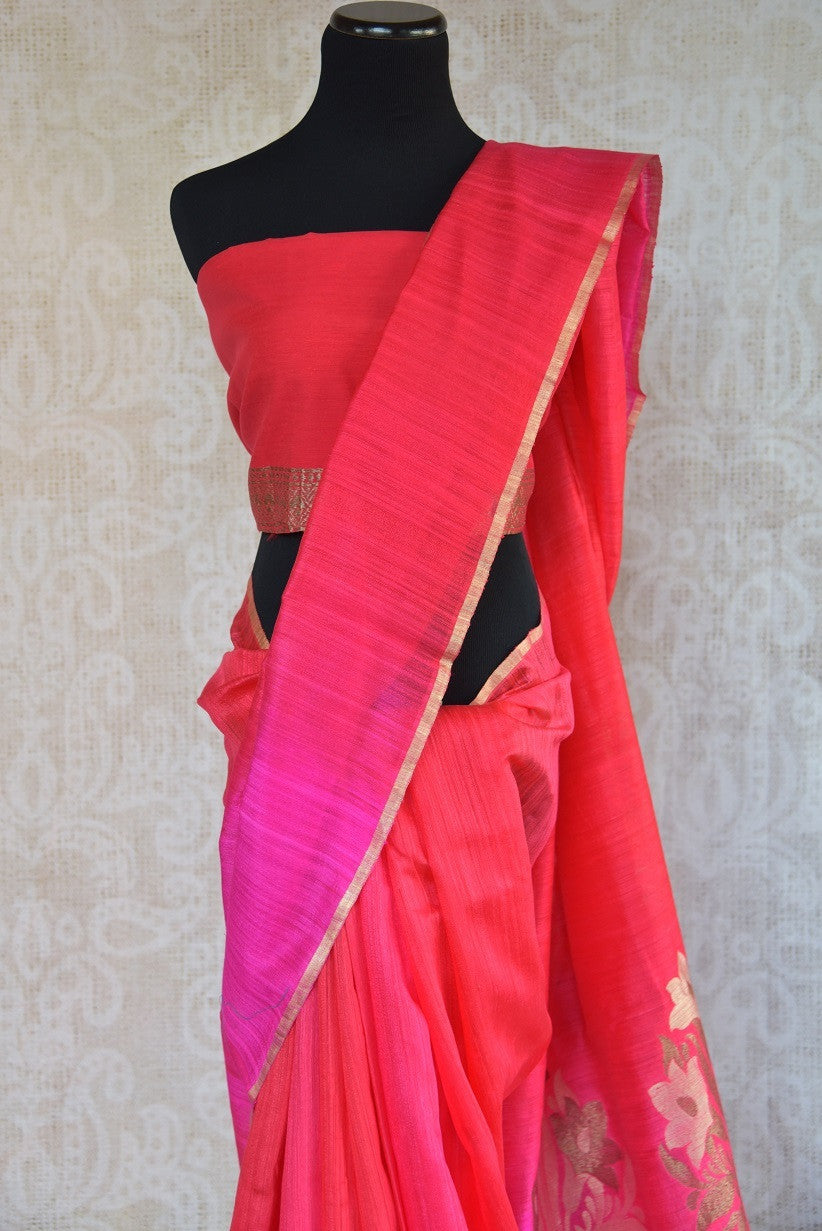 90C282 Striking saree in lovely shades of red and pink with a gold trim and a stunning floral zari pallu. The traditional matka Banarasi saree is an evergreen pick for your Indian ethnic wear wardrobe.
