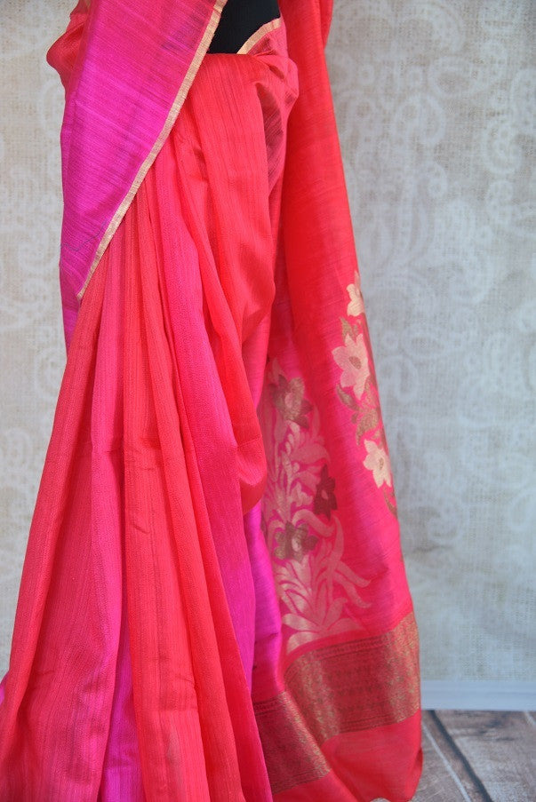90C282 Traditional red and pink saree with a stunning floral zari pallu. The traditional matka Banarasi saree is an evergreen pick for your Indian wear wardrobe. This ethnic outfit is a lovely pick for pujas and festive occasions.
