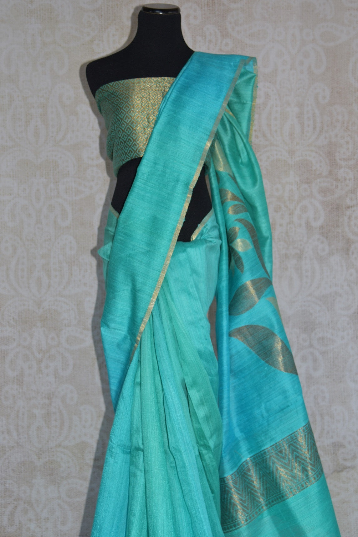 90C277 Buy this blue-green matka Banarasi saree online in USA at our ethnic fashion store - Pure Elegance. Topped with a ravishing zari pallu, this Indian sari is a great pick for festive occasions and pujas.
