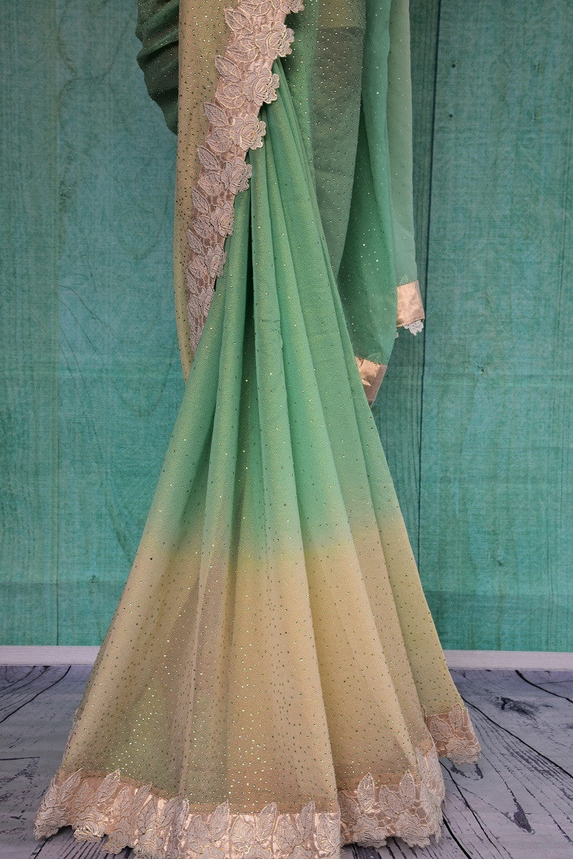 90C144 Green and cream shaded saree with with a lace border. The delicate georgette saree can be bought at our Indian fashion store in USA - Pure Elegance - online and in Edison, new Jersey.