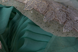 90C144 Elegant shaded green and cream saree online in USA with with a lace border. The delicate georgette saree can be bought at our Indian wear store - Pure Elegance.
