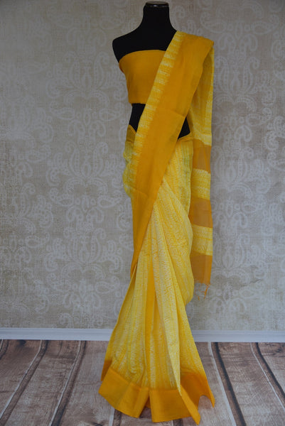 90B548 A tie and dye yellow, linen saree. The simple Indian outfit available at our ethnic wear store is perfect for pujas, festive occasions and functions. The shiburi printed sari will make you fall in love in an instant!