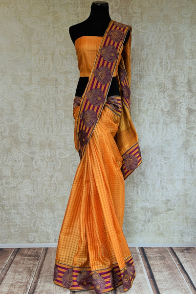 90B637 Orange tussar silk saree with Banarasi border available online at our Indian clothing store in USA. The sari makes for an evergreen traditional Indian outfit and is ideal for Indian wedding functions and festivities.