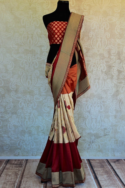 90A831 This traditional tussar saree in maroon and beige hues is a gorgeous ethnic outfit to wear at Indian weddings and festivities. The designer saree with a golden border can be bought online at our ethnic clothing store in USA.