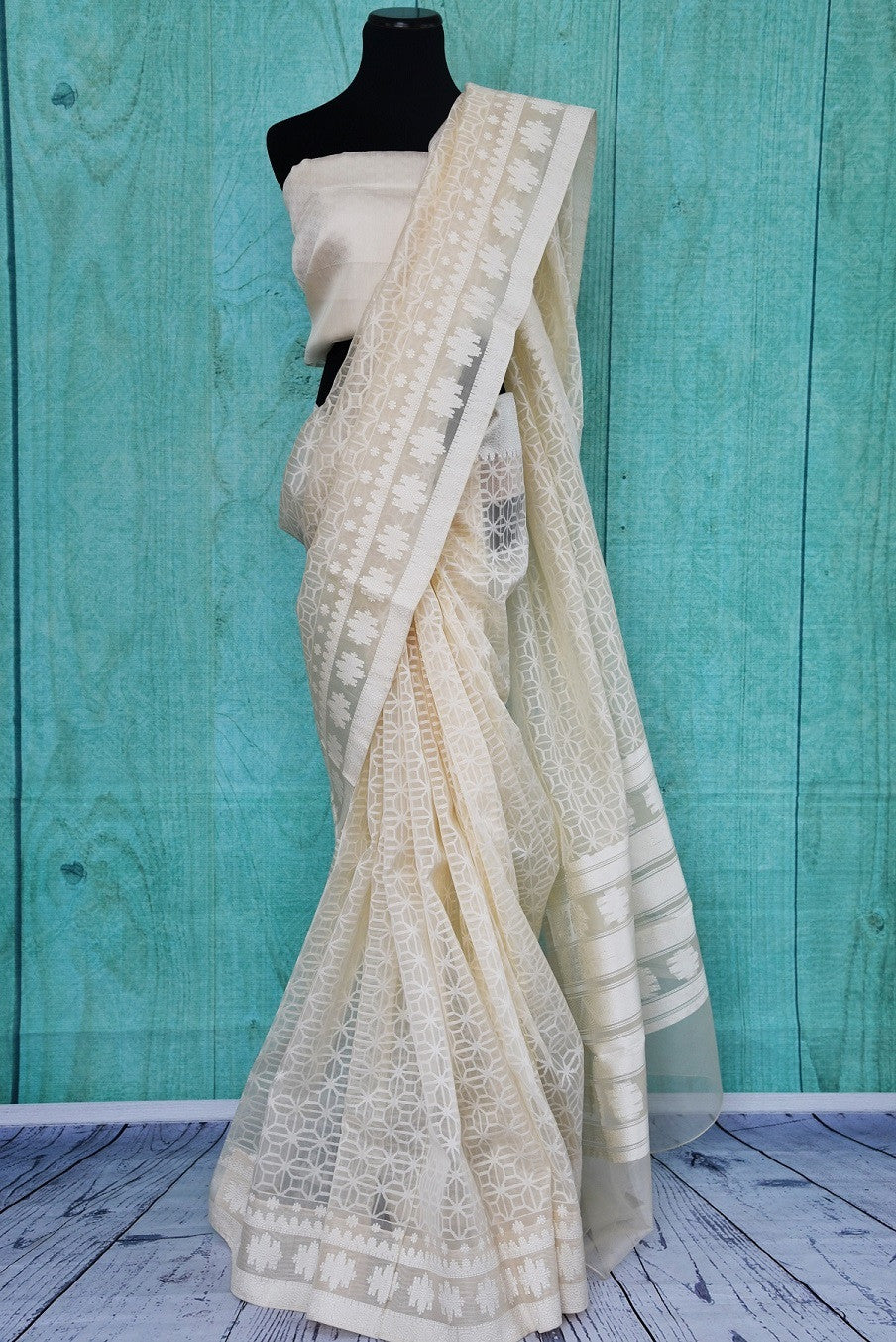 90A919 Resham organza Banarasi saree in a splendid white hue. The ethnic saree available online in USA at our store Pure Elegance is the perfect party wear saree for all seasons!