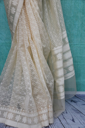 90A919 Resham organza Banarasi saree in a lovely white color. The readymade saree available online in USA at our store Pure Elegance is the perfect party wear saree for this festive season.
