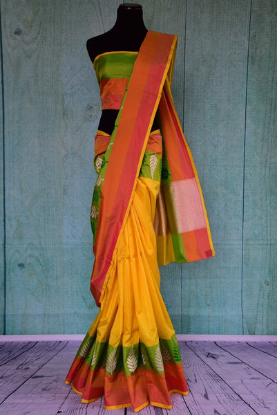 90A828 Traditional Banarasi silk saree for sale online at our Indian wear store in USA. The yellow, orange & green saree makes for a beautiful ethnic outfit that is versatile and lovely!