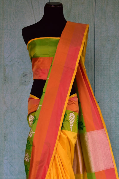90A828 Traditional Banarasi silk saree for sale online at our Indian clothing store in USA. The yellow, orange & green saree makes for a beautiful ethnic outfit that is simple, yet eye catching!