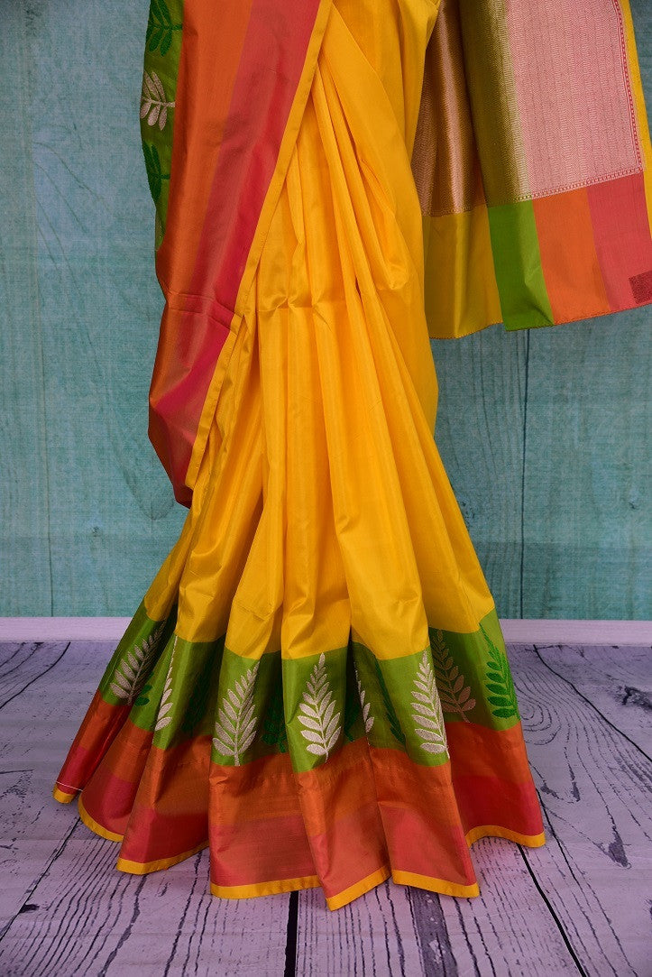 90A828 Traditional Banarasi silk saree for sale online at our Indian clothing store in USA. The yellow, orange & green saree makes for a beautiful ethnic outfit that will be a wondeful pick for festive occasions and pujas.