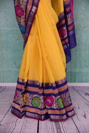 90B934 Lovely yellow resham Banarasi saree from India online in USA with multi-color border and blue blouse. The traditional saree is perfect for festive occasions and Indian weddings.