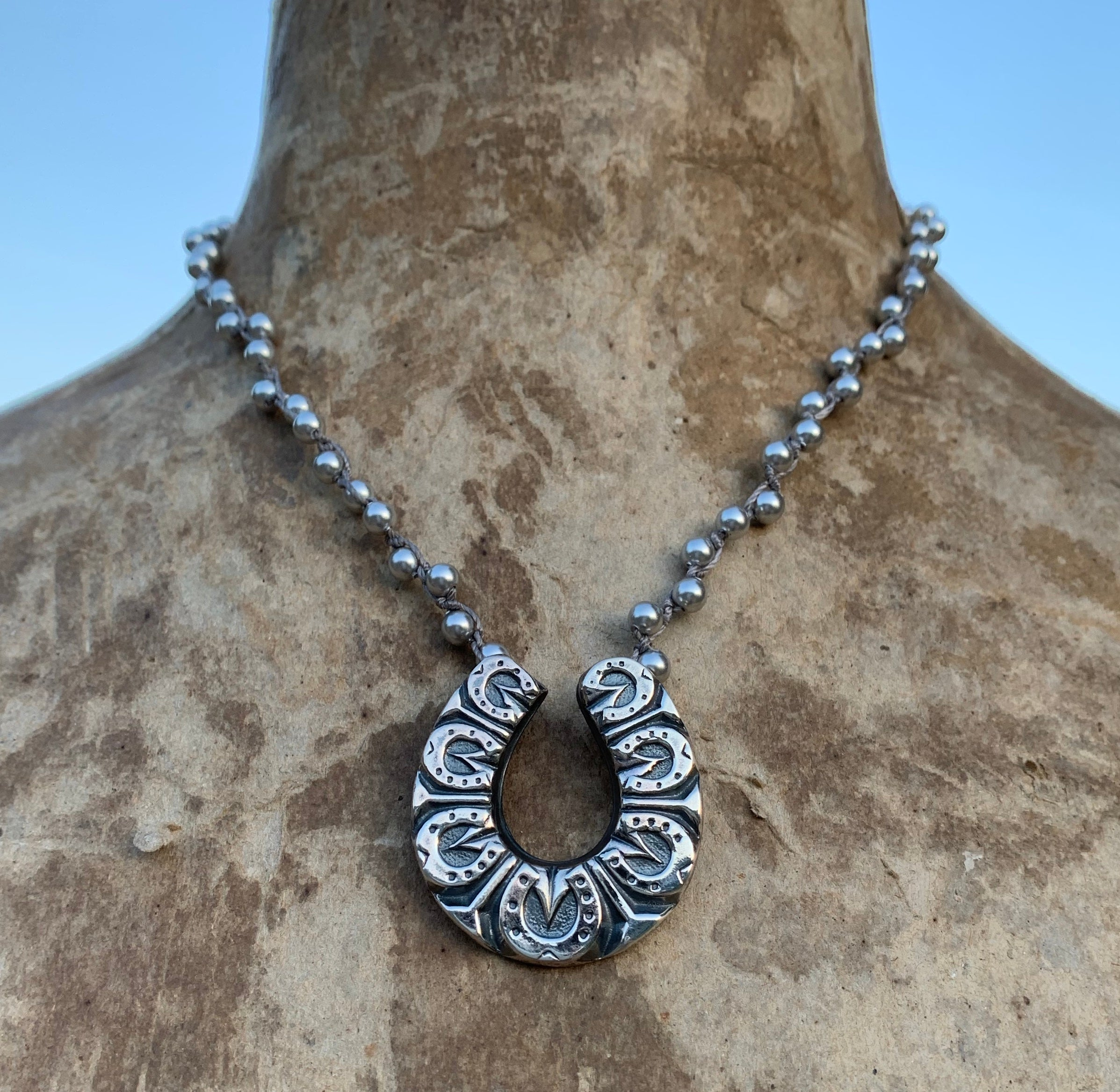 Lucky Seven Horse Shoe on Silver Pearls