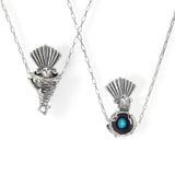 This pendant is interactive - the fantail can be lifted up from the nest to reveal the turquoise egg nestled inside, and yet the fantail is securely threaded onto the chain and sits perfectly inside the nest when worn.