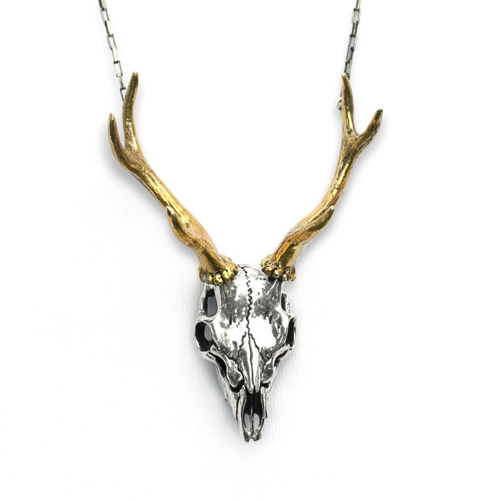 The Stag is the majestic King of the forest. His skull is like a hunters trophy immortalising regal dominance.  Made from sterling silver with brass antlers.
