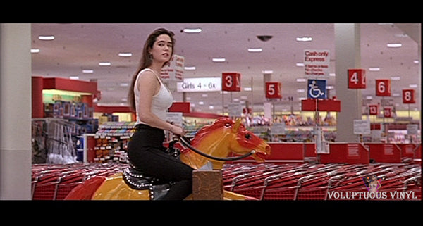 Jennifer Connelly riding a mechanical horse