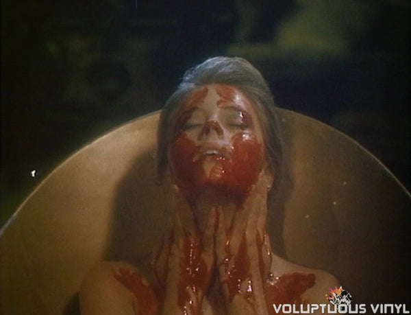 Nicole Eggert bathing in blood in The Haunting of Morella