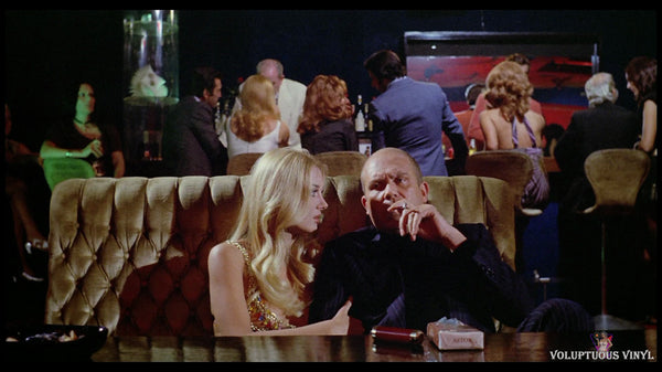 Barbara Bouchet and Gastone Moschin in Caliber 9