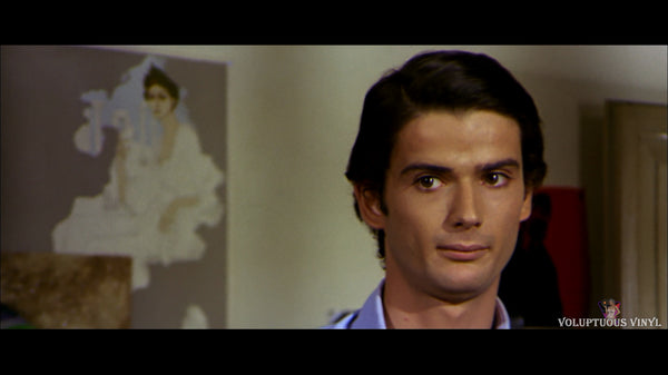 Pino starring at Nadin (Barbara Bouchet)
