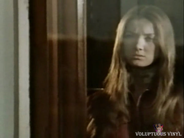 Barbara Bouchet staring outside