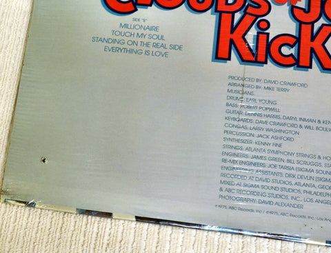Back album drill hole on cover to Mighty Clouds Of Joy vinyl record Kickin'.