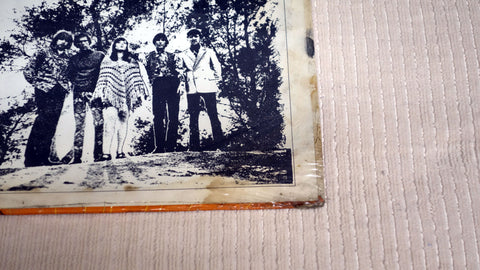 Back album cover damage to The Sunshine Company vinyl record Happy Is.