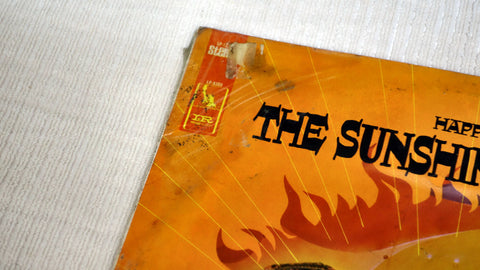 Front album cover damage to The Sunshine Company vinyl record Happy Is.