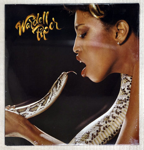 Front album cover to Wardell Piper record, woman kissing a snake.