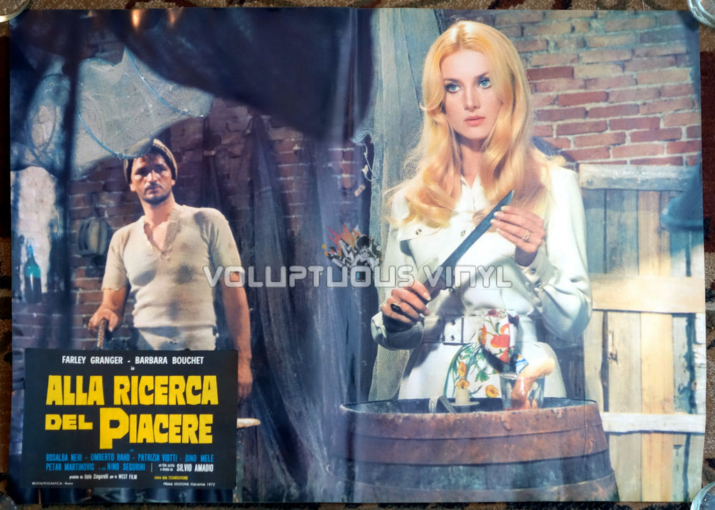 Barbara Bouchet with a knife in Amuck