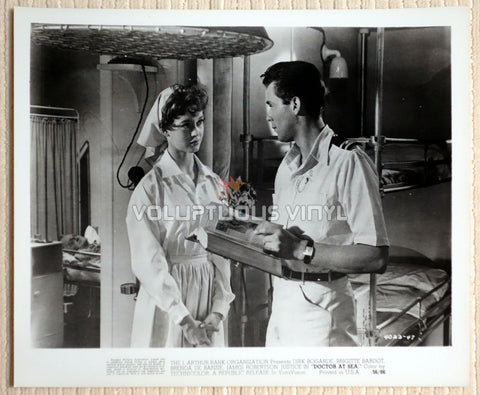 Brigitte Bardot dressed as a nurse with Dirk Bogarde in the film Doctor At Sea