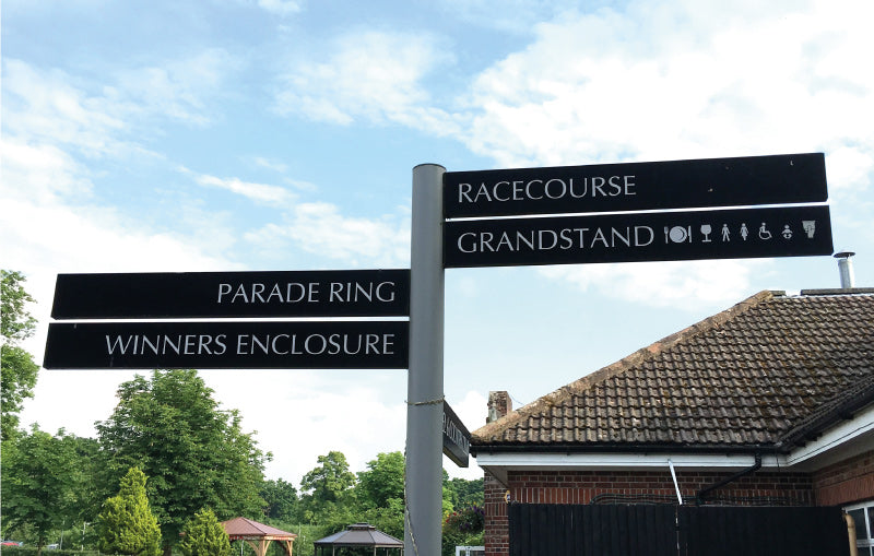 the race course sign posts