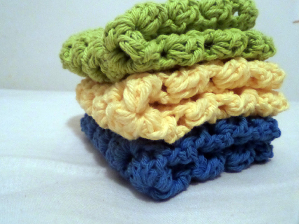 yellow, blue, and green granny square crochet dishcloths