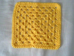 yellow granny square crochet dishcloths