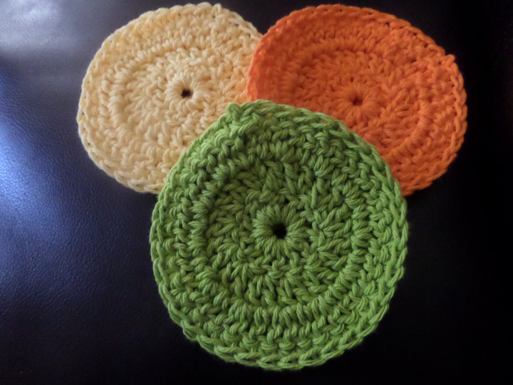 yellow orange green round crochet coaster