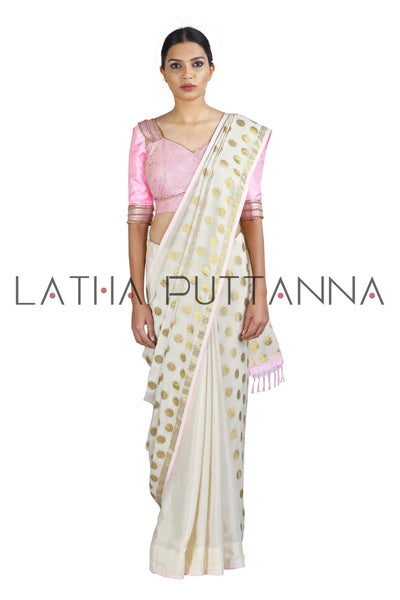 Kumkuma - Dramatic Off-White Saree with Gold Polkas