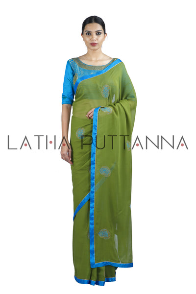 Kesari – Mehendi Green Saree with Mango Buttas