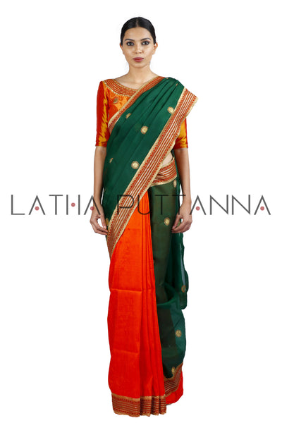 Pitambari - Raw silk and Organza saree with gold beaten chakra butta