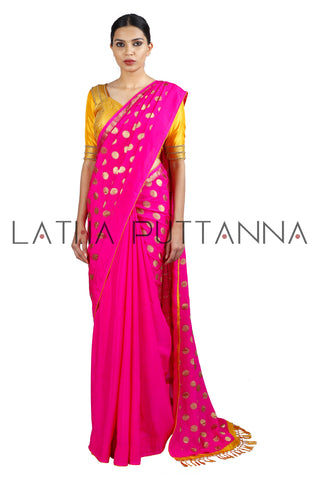 Kumkuma - Dramatic Pink Saree with Gold Polkas
