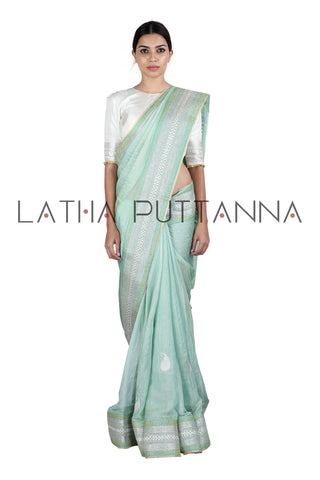 Sea  green tissue saree with silver work