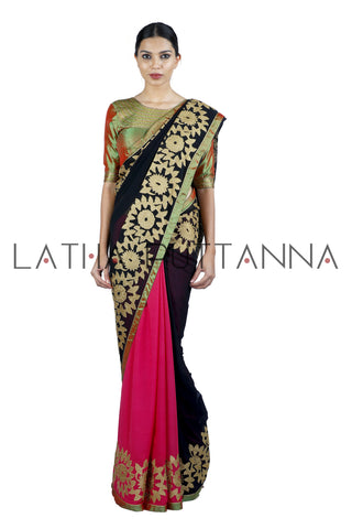 Mrinalini - Dusty Rose and Black Georgette Saree with Flower Balli