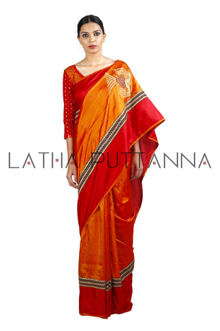 Gandberunda  -  Orange Silk saree  with beautiful thread woven pallu