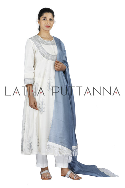 White Salwar with blue embroidery