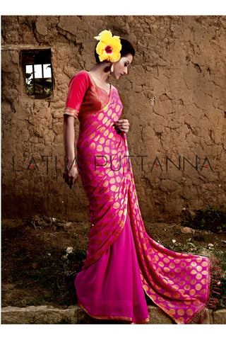 Kumkuma - Pink Georgette saree with one half covered in gold polka dots