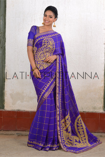 Swaraga - Purple georgette saree with gold checks