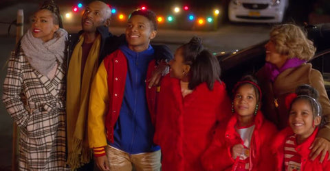 Holiday Rush - A Coloured Family Standing Outside on Christmas